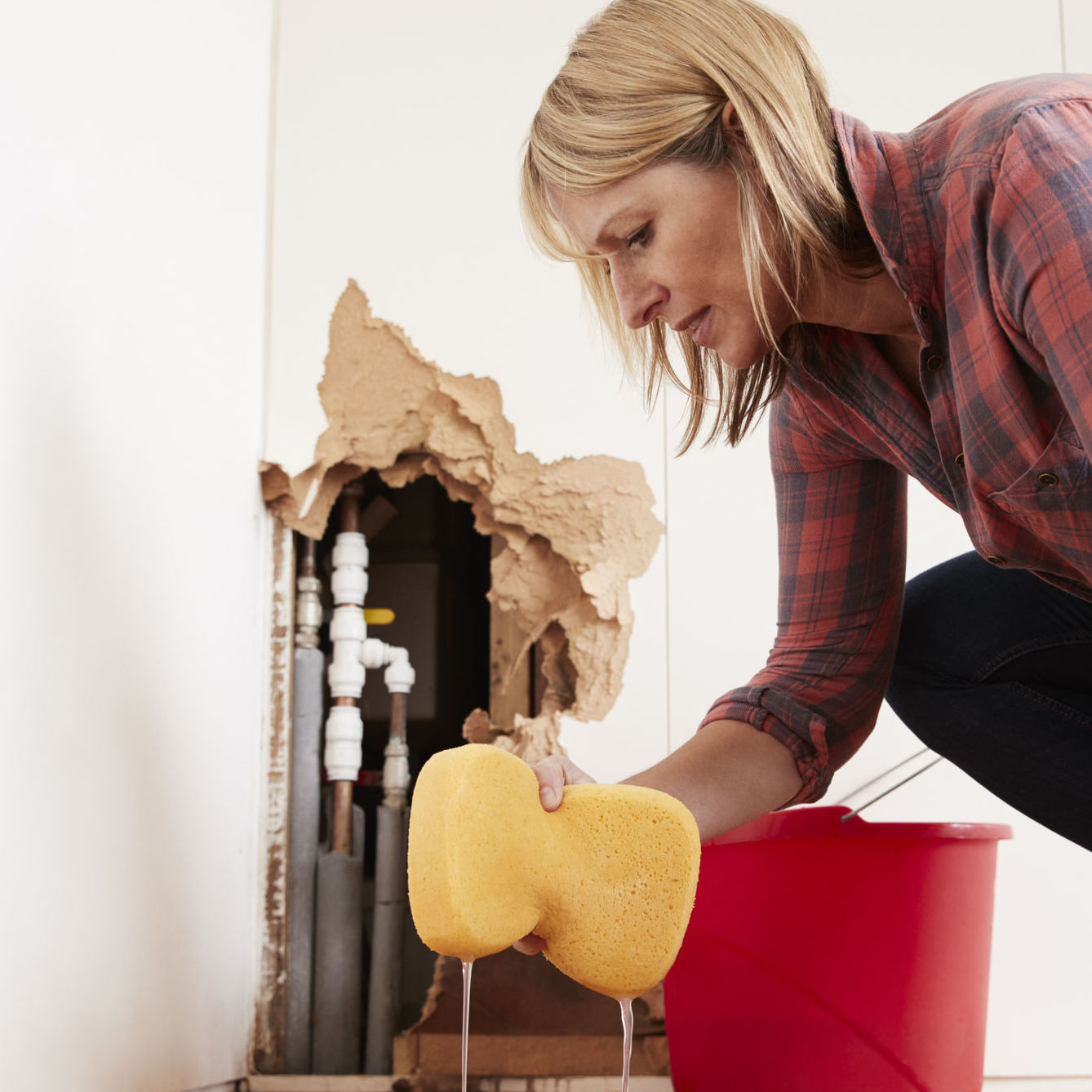 woman cleaning structural leaks
